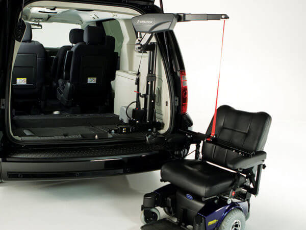 Big Lifter in back of minivan attached to two wheel power wheelchair